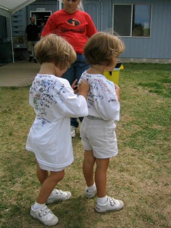 2005 During shirt signing all they could write at age 3 was an L or an M (Elli and Emmi)